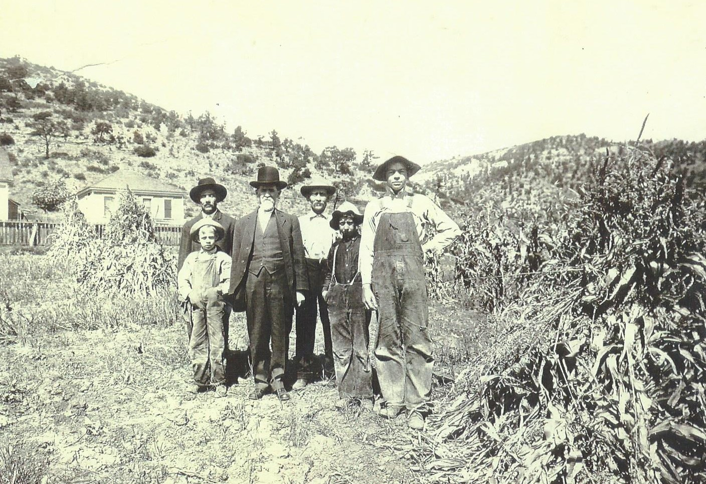 Writing a biography on my great-grandfather, in the hat and white shirt in the middle, helped me grow closer to my family. Kids can do the same as they interview family and write biographies!